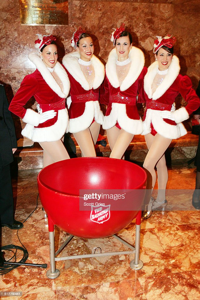 The Radio City Rockettes pose for a photo during a ceremony to help The Salvation Army kick off its annual Christmas kettle effort at the Trump Tower...