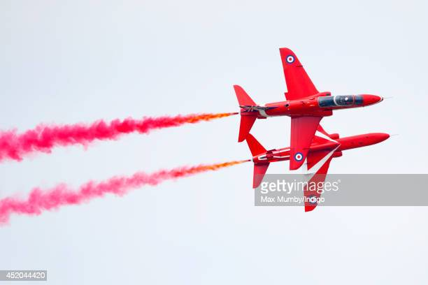 The RAF Aerobatic Team The Red Arrows fly in formation at the Royal International Air Tattoo at RAF Fairford on July 11 2014 in Fairford England