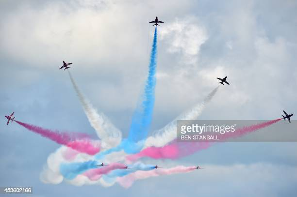 The RAF Aerobatic Team The Red Arrows perform at the Eastbourne airshow 'Airbourne' off the coast at Eastbourne southern England on August 14 2014...