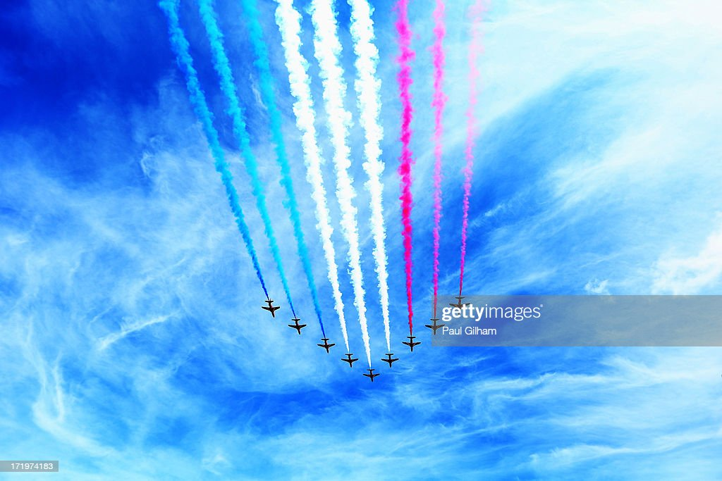 The RAF Red Arrows display team perform before the British Formula One Grand Prix at Silverstone Circuit on June 30, 2013 in Northampton, England.