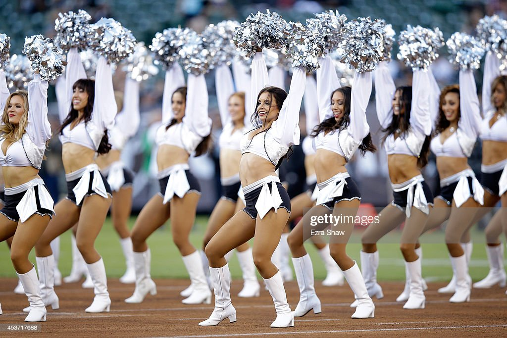 The Raiderettes the Oakland Raiders cheerleaders perform during the Oakland Raiders preseason game against the Detroit Lions at Oco Coliseum on...
