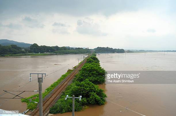 The railway track of JR Ou Line runs in the foolded rice paddy on August 9 2013 in Odate Akita Japan The torrential rain hits Tohoku region killed...