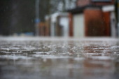 The rain continues to fall on a flooded street in Worcester on February 14 2014 in Worcester United Kingdom Flood water has remained high in some...