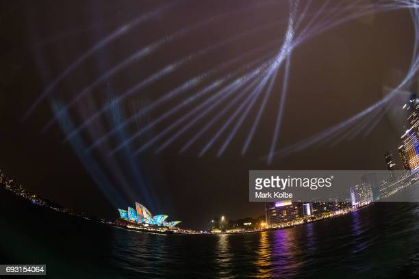 The rain is seen falling as Sydney Opera House sails and surrounds are lit as part of the Vivid Festival on June 6 2017 in Sydney Australia Vivid...