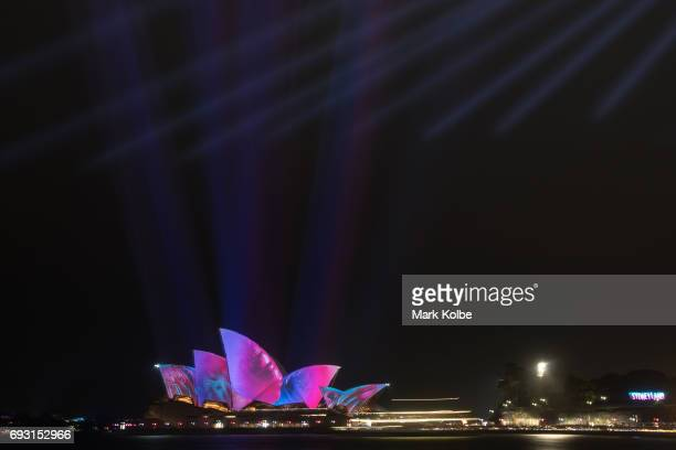 The rain is seen falling as Sydney Opera House sails are lit as part of the the Vivid Festival on June 6 2017 in Sydney Australia Vivid Sydney is an...