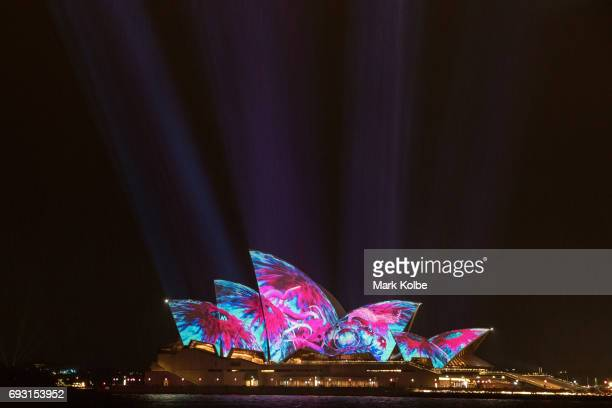 The rain is seen falling as Sydney Opera House sails are lit as part of the Vivid Festival on June 6 2017 in Sydney Australia Vivid Sydney is an...
