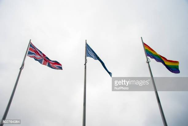The Rainbow flag waves outside the City Hall with the EU and Union flags London on June 28 2017 The flag has been put to celebrate Pride in London...