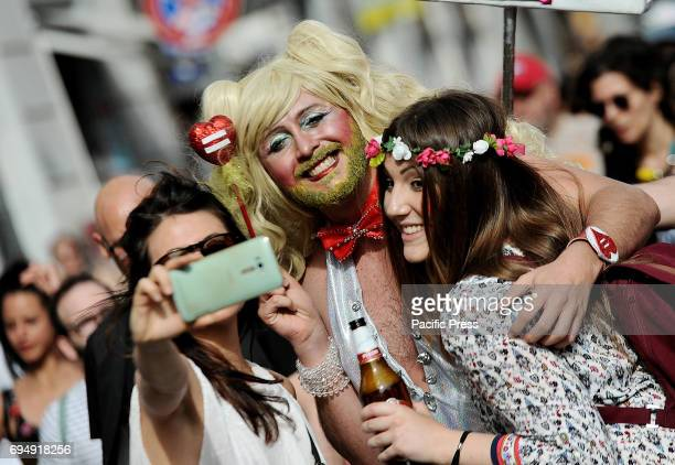 The rainbow wave paved through the streets of central Rome claiming the importance of their rights A concentration of music cheerful colors between...