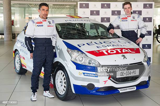 The rally driver Jose Antonio Suarez and Candido Carrera attend 'Peugeot 208 Rally Cup' photocall at the office of peugeot spai on March 31 2015 in...