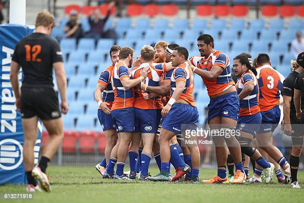 The Ram celebrate scorng a try during the round seven NRC match between the Western Sydney Rams and the NSW Country Eagles at Concord Oval on October...