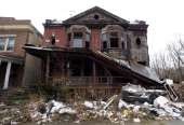 DETROIT MI FEBRUARY 24 The ramshackle remains of a home in a Detroit neighborhood Many buildings in Detroit are in disrepair Many lots have been...