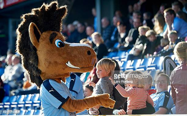 The Randers FC mascot cheer with youth fans during the Danish Alka Superliga match between Randers FC and Hobro IK at BioNutria Park on October 3...