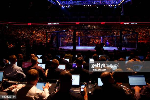 The ranks of journalists beside the octagon before the Michael Bisping of Great Britain versus Anderson Silva of Brazil fight at the UFC Ultimate...