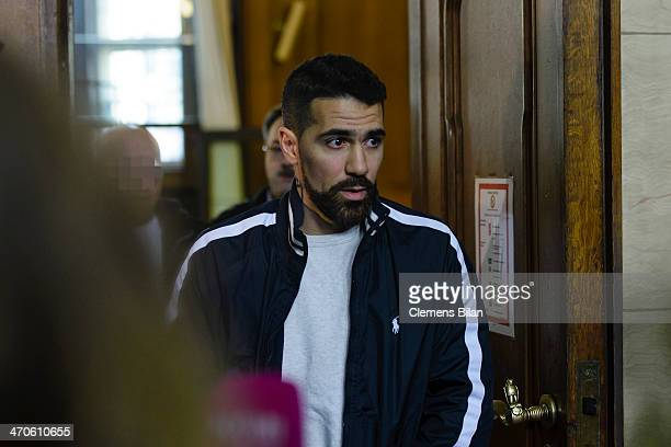 The rap musician Bushido and another accused leave a court room after an assualt hearing on February 20 2014 in Berlin Germany Bushido was acquitted...