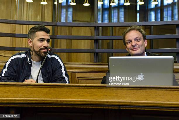 The rap musician Bushido and his lawyer Stefan Conen wait at the Kriminalgericht Moabit before an assualt hearing on February 20 2014 in Berlin...