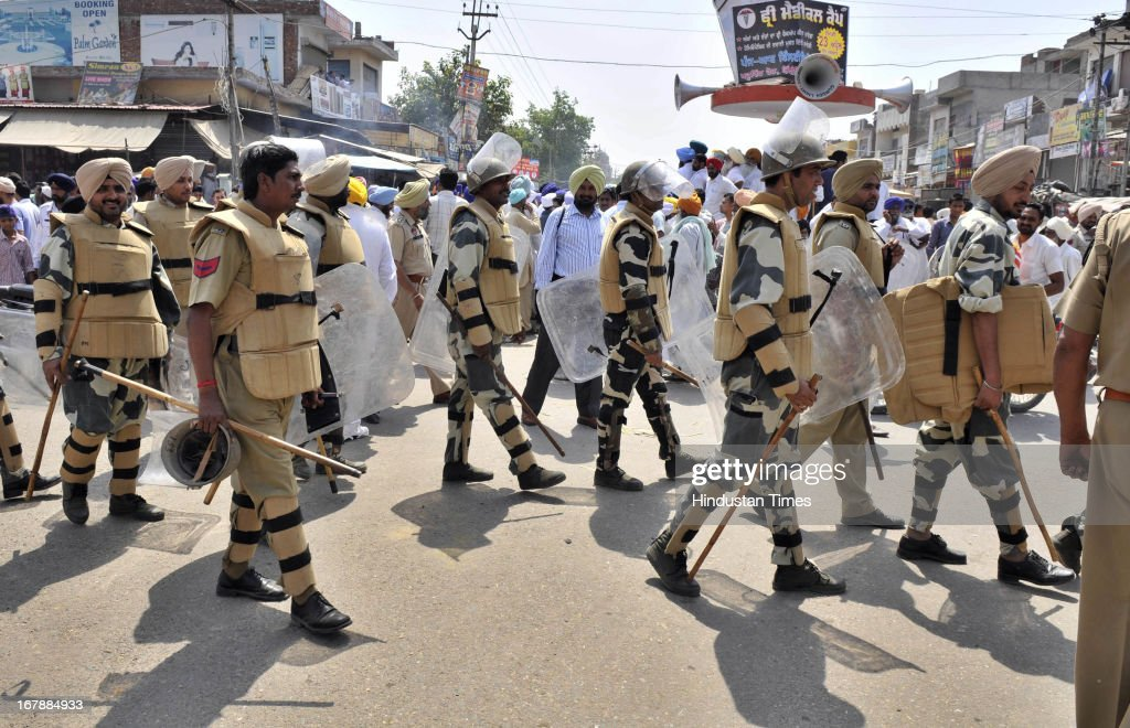 The rapid action force moving near spot where residents of the native village Bikhiwind of Sarabjit Singh blocked the main road and burning the effigy of Pakistan and Indian governments during protest on May 2, 2013 about 40 KMS from Amritsar, India. Sarabjit Singh, died early today after being comatose for almost a week following an attack by other prisoners at a Lahore jail.