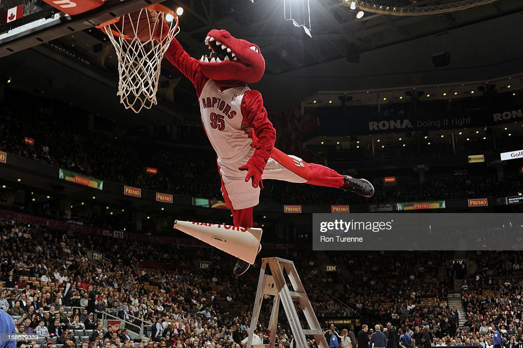 'The Raptor', mascot of the Toronto Raptors, dunks the ball during the game against the Brooklyn Nets during on December 12, 2012 at the Air Canada Centre in Toronto, Ontario, Canada.