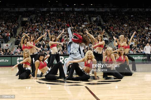 The Raptors Dance Pak and team mascot Raptor entertain the crowd during the NBA game between the Portland Trail Blazers and the Toronto Raptors at...