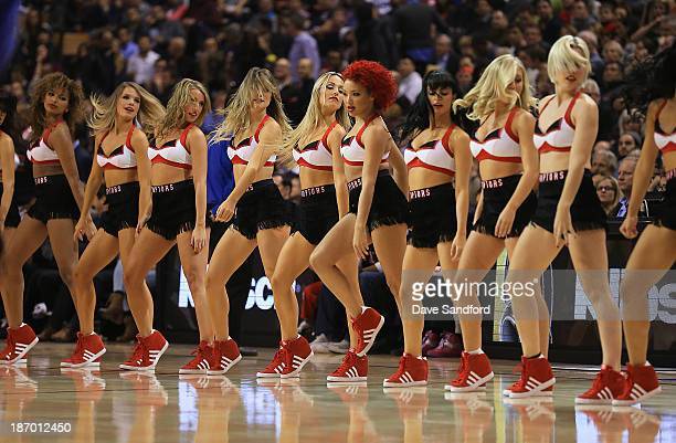 The Raptors Dance Pak perform as the Boston Celtics face the Toronto Raptors during their NBA game at the Air Canada Centre on October 30 2013 in...