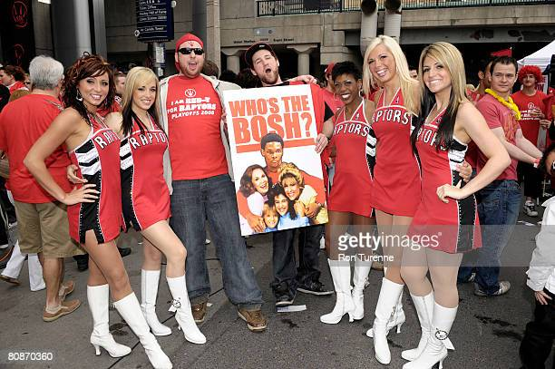The Raptors Dance Pak pose with fans before Game Four of the Eastern Conference Quarterfinals between the Orlando Magic and Toronto Raptors during...