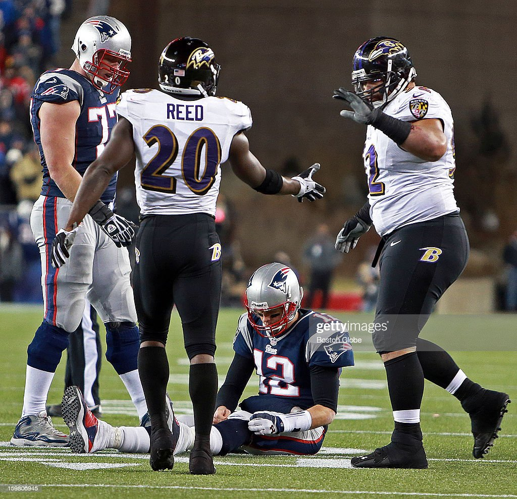 The Ravens' Ed Reed (#20) and Haloti Ngata, right, celebrate over Patriots quarterback Tom Brady after he couldn't complete a fourth down pass that gave the ball to Baltimore. The New England Patriots hosted the Baltimore Ravens in the AFC Championship Game at Gillette Stadium.