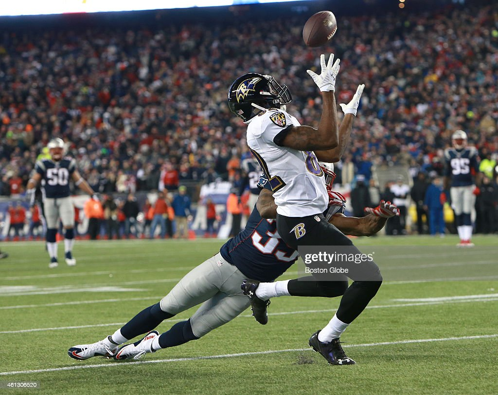 The Ravens' Torrey Smith catches a pass against the Patriots' Brandon Browner in the third quarter of the AFC Divisional Playoff Game between the New...
