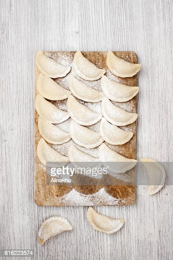 The raw dumplings lie on the board : Stock Photo