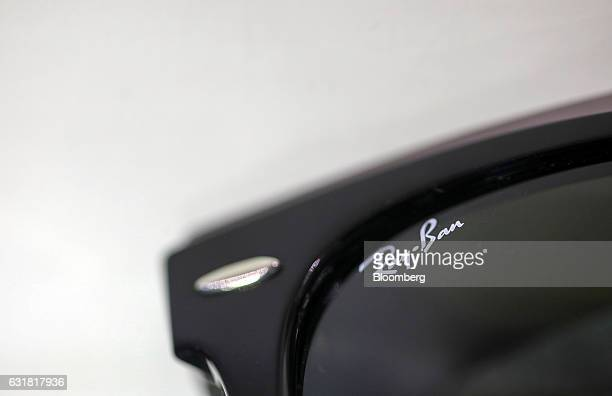 The RayBan brand logo is displayed on the lens of a pair of Wayfarer sunglasses manufactured by Luxottica Group SpA in an opticians in London UK on...