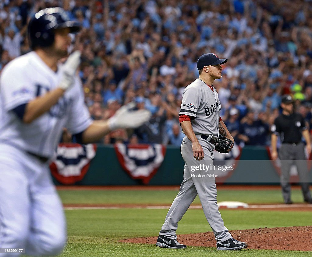 The Rays David DeJesus claps as he and Red Sox starting pitcher Jake Peavy watch his sixth inning single drop in safely to drive in Yunel Escobar and give Tampa Bay a 1-0 lead. The Boston Red Sox visited the Tampa Bay Rays in Game Four of the ALDS baseball playoffs at Tropicana Field.