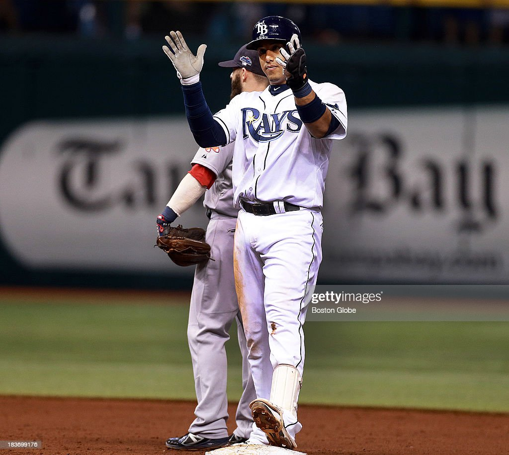 The Rays Yunel Escobar applauds his leadoff double in the sixth inning. He would score the first run of the game from there later in the frame on a single by teammate David DeJesus. The Boston Red Sox visited the Tampa Bay Rays in Game Four of the ALDS baseball playoffs at Tropicana Field.
