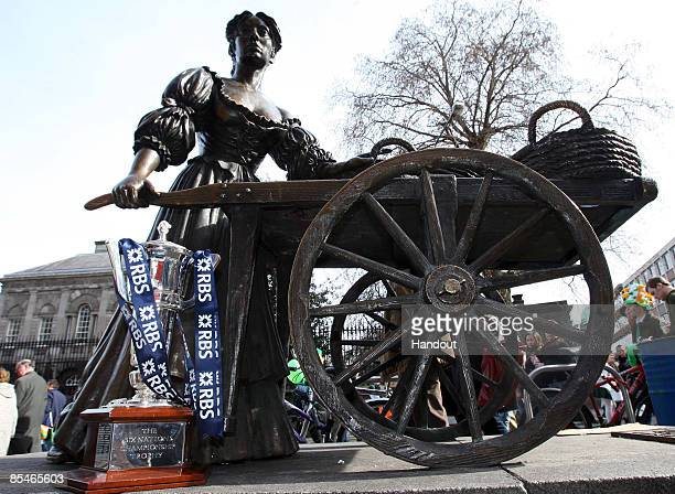 The RBS 6 Nations Trophy is displayed in front of the statue of Molly Malone during St Patricks Day Parades on March 17 2009 in Dublin Ireland...