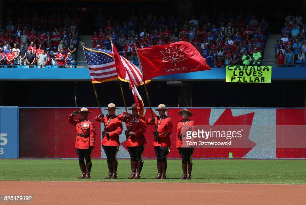 The RCMP Mounties color guard stand for the playing of the Canadian anthem before the start of the Toronto Blue Jays MLB game against the Los Angeles...