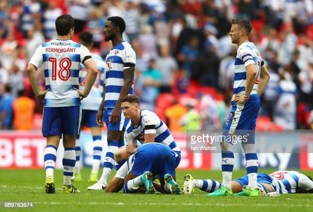 The Reading players are dejected after losing a penalty shoot out after the Sky Bet Championship play off final between Huddersfield and Reading at...