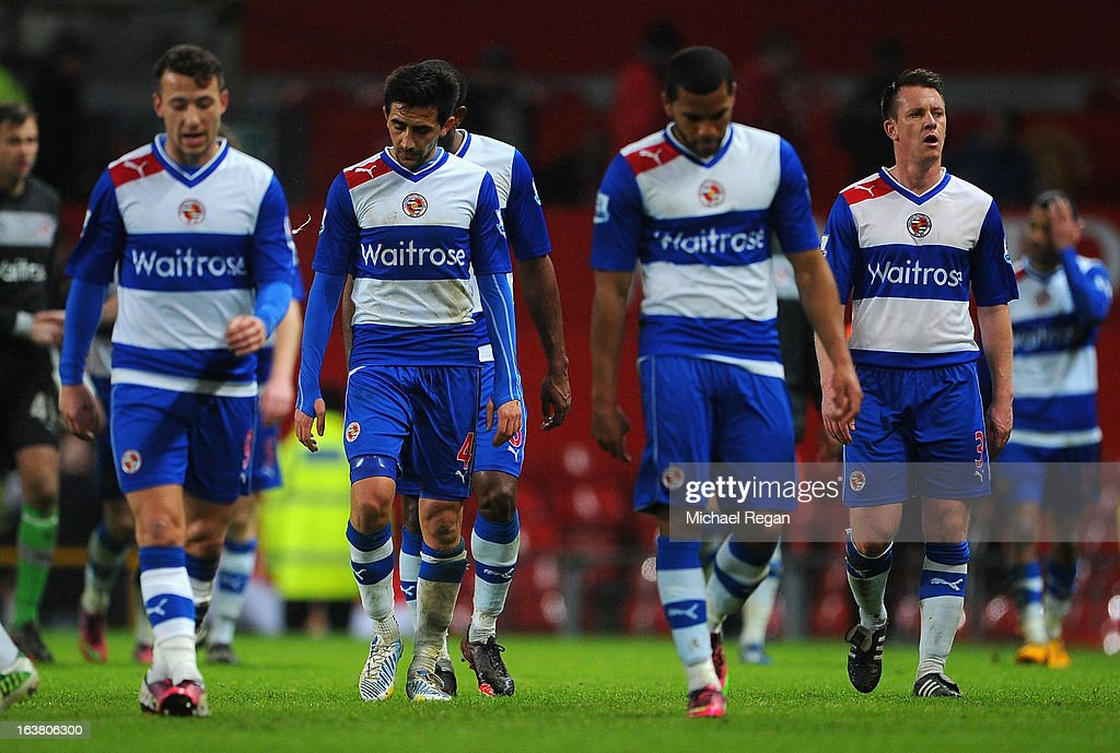 The Reading players look dejected at the end of the Barclays Premier League match between Manchester United and Reading at Old Trafford on March 16, 2013 in Manchester, England.