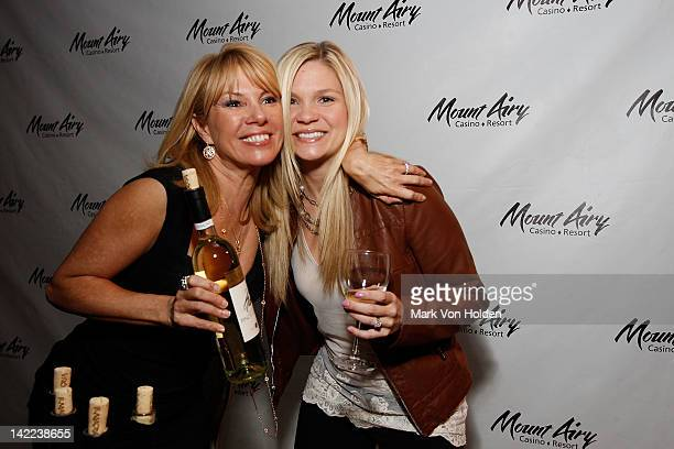 The Real Housewives Of New York's Ramona Singer poses with fan Michelle Schrader at Mount Airy Casino Resort during a special tasting of Ramona's...