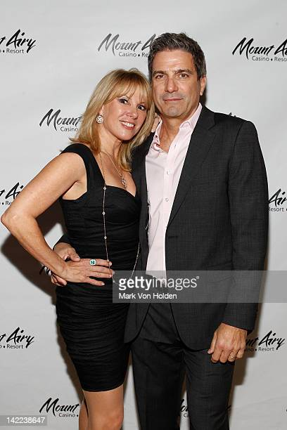 The Real Housewives Of New York's Ramona Singer poses with husband Mario Singer at Mount Airy Casino Resort during a special tasting of Ramona's...