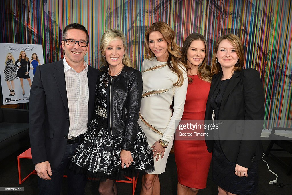 'The Real Housewives of Vancouver Jody Claman, Ronnie Negus and Mary Zilba pose with Producers Grant Greschuk and Krista Kelloway attend the Shaw Media Press Conference held at the Shaw Media Building on December 12, 2012 in Toronto, Canada. attends the Shaw Media Press Conference held at the Shaw Media Building on December 12, 2012 in Toronto, Canada.