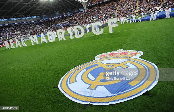 The Real Madrid club badge is seen on the pitch prior to the UEFA Super Cup match between Real Madrid and Sevilla FC at Cardiff City Stadium on...
