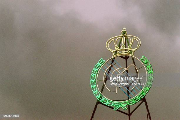 The Real Madrid club badge lights up the dull sky