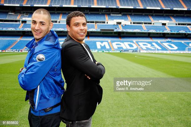 The Real Madrid player Karim Benzema poses with Ronaldo on the pitch of the Bernabeu Stadium on September 29 2009 in Madrid Spain