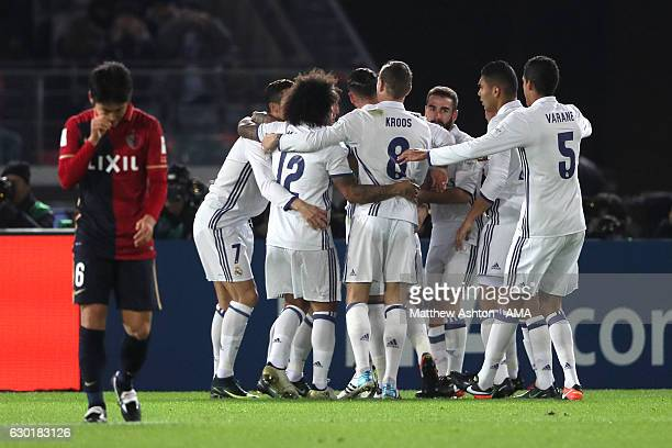 The Real Madrid players celebrate the goal of Karim Benzema whch made the score 10 during the FIFA Club World Cup final match between Real Madrid and...