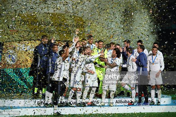 The Real Madrid players celebrate with the trophy at the end of the FIFA Club World Cup final match between Real Madrid and Kashima Antlers at...
