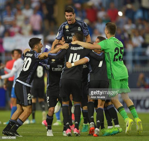 The Real Madrid squad celebrate winning the La Liga title following the La Liga match between Malaga and Real Madrid at La Rosaleda Stadium on May 21...