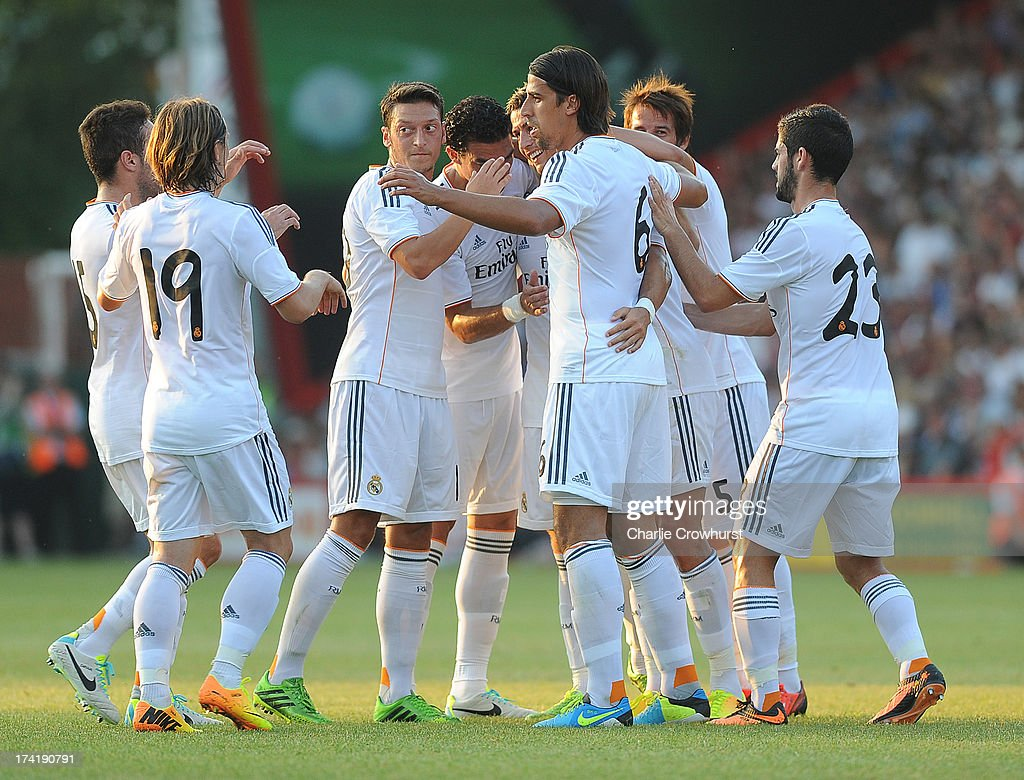The Real Madrid team celebrate the first goal of the game scores by Cristiano Ronaldo during the pre season friendly match between Bournemouth and Real Madrid at Goldsands Stadium on July 21, 2013 in Bournemouth, England,