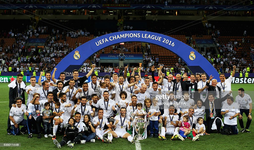 The Real Madrid team celebrate with the trophy during the UEFA Champions League Final between Real Madrid and Club Atletico de Madrid at Stadio Giuseppe Meazza on May 28, 2016 in Milan, Italy.