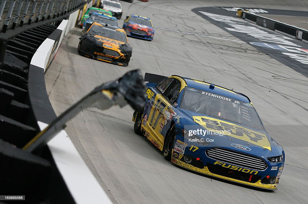 The rear end bumper of the #17 Best Buy Ford, driven by Ricky Stenhouse Jr., is seen jammed in the safer barrier during the NASCAR Sprint Cup Series Food City 500 at Bristol Motor Speedway on March 17, 2013 in Bristol, Tennessee.