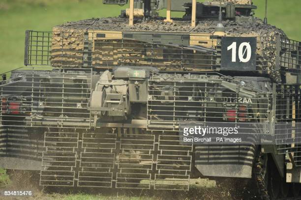 The rear of a Challenger 2 tank with extra armour fitted in the form of heavy duty metal grids causing antitank weapons to detonate further from the...