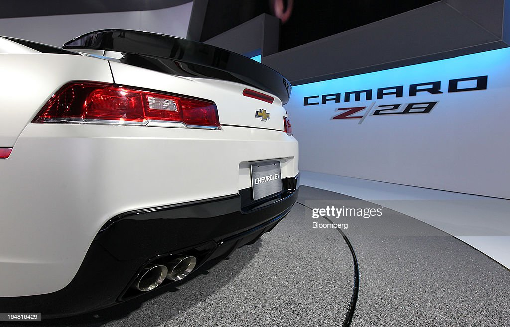The rear of a Chevrolet 2014 Camaro Z28 vehicle is seen while on display at the company's booth during the 2013 New York International Auto Show in New York, U.S., on Thursday, March 28, 2013. The 113th New York International Auto Show, which runs from March 29 to April 7, features 1,000 vehicles as well the latest in tech, safety and innovation. Photographer: Jin Lee/Bloomberg via Getty Images