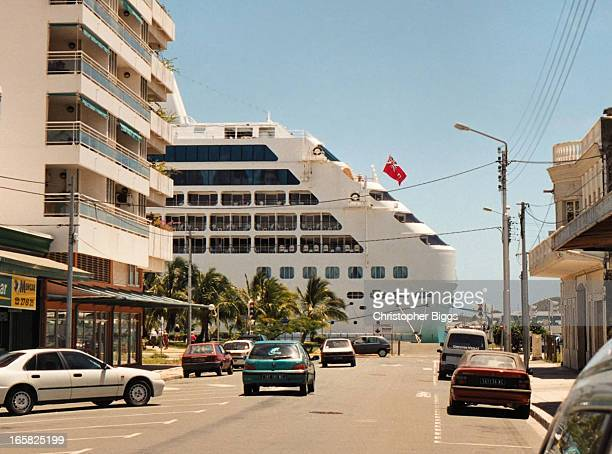 CONTENT] The rear of the cruise ship Pacific Princess docked at the Port of Nouméa Taken from one of the main streets Rue Jean Jaures in the city of...