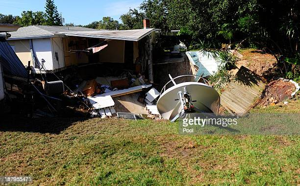The rear portion of a residential home is consumed by a sinkhole November 14 2013 in Dunedin Florida According to reports the large sinkhole began to...